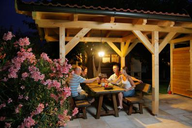 Cosy BBQ nights in the roofed sitting area